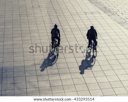 Silhouette man on bicycle outdoor Urban lifestyle