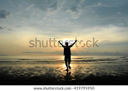 silhouette man running Background sunset on the sea - stock photo