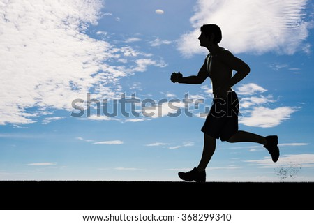 silhouette man running on blue sky background