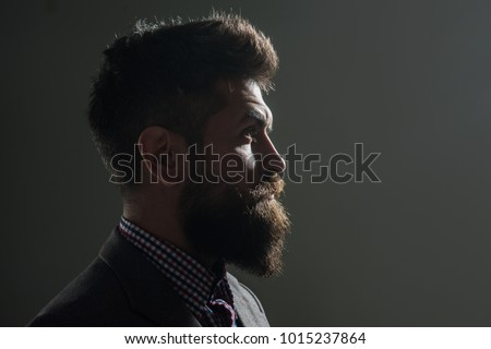 Silhouette man with beard and mustache in vintage style. Hipster profile portrait. Silhouette serious bearded man, looking forward. Side view portrait. Copy space for yours advertise.