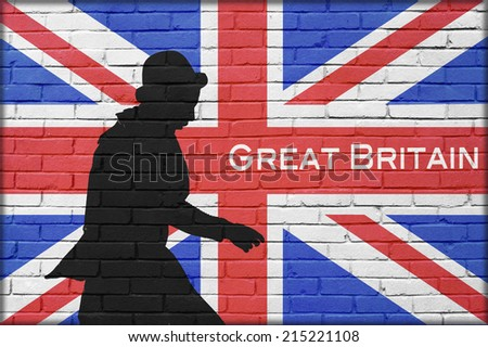 silhouette man with bowler in brick wall background with great britain painted flag and Great Britain text