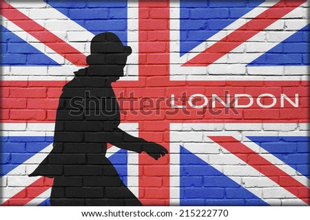 silhouette man with bowler in brick wall background with great britain painted flag and London text - stock photo
