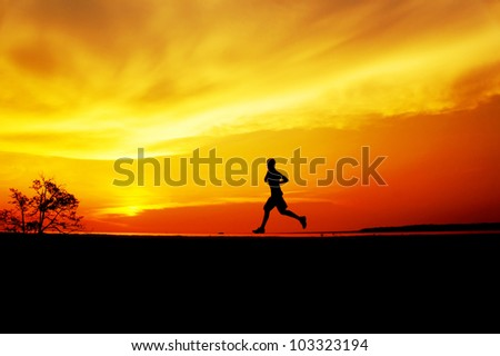 Silhouette men jogging on yellow sunset background