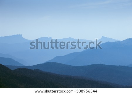 silhouette mountain under blue sky - stock photo
