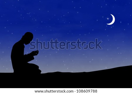 Silhouette muslim man praying at night with moon background during the month of ramadan - stock photo