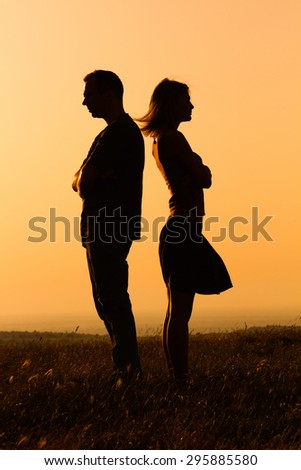 Silhouette of a angry woman and man on each other. Relationship difficulties - stock photo