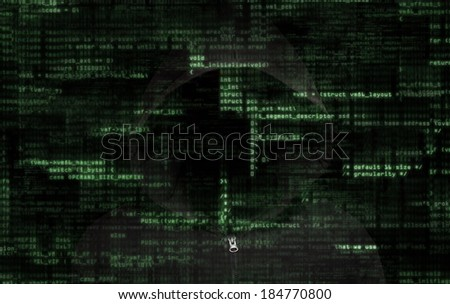 Silhouette of a anonymous person with binary codes from monitor - stock photo