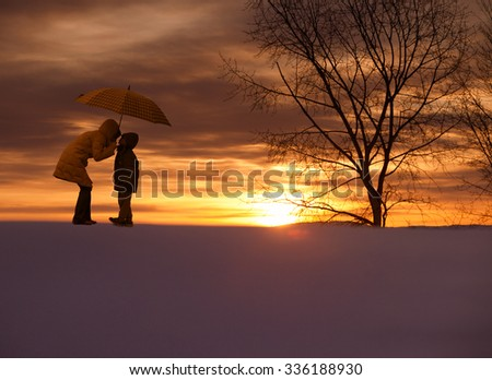silhouette of a Asian mother and son stay in sunset