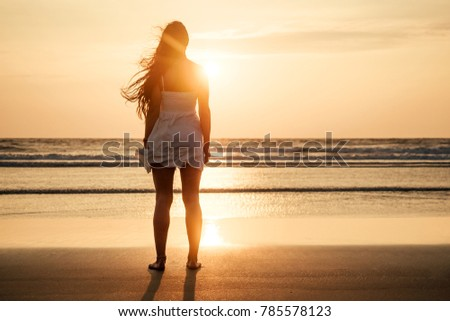 silhouette of a beautiful woman at sunset