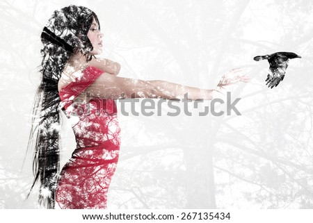 Silhouette of a beautiful woman with a bird. Conceptual photo with the effect it double exposure. - stock photo