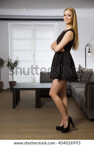 Silhouette of a beautiful young adult slim sexy and attractive sensuality pretty blonde woman in elegance fashionable dress