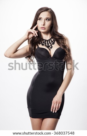 Silhouette of a beautiful young adult slim sexy and attractive sensuality pretty brunette woman in black elegance fashionable dress isolated on white background