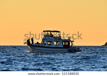 Silhouette of a boat and fisherman