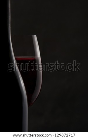 Silhouette of a Bottle and Red Wine Glass