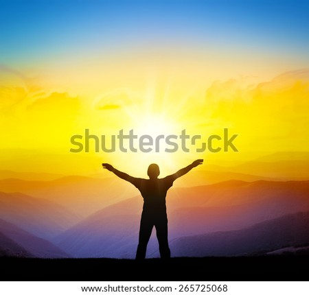 Silhouette of a champion on mountain top. Sport and active life concept. - stock photo