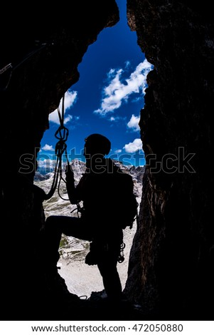 Silhouette of a climber during multi-pitch mountain ascent