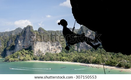 "Silhouette of a climber from thaiwand wall ""Rai Lay west beach"""