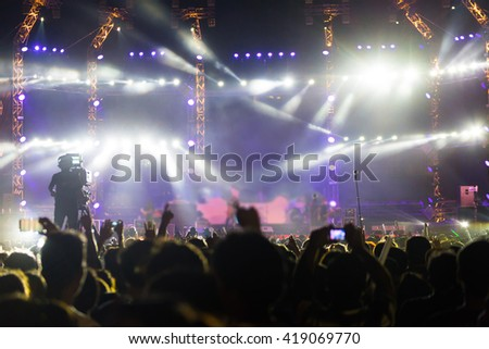 silhouette of a crowd of cheering fans during a live concert, live music concert, - stock photo