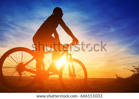 stock-photo-silhouette-of-a-cyclist-with