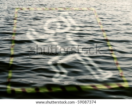 silhouette of a dead man on the water over police tape - stock photo