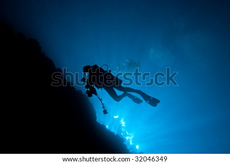 Silhouette of a diver - stock photo