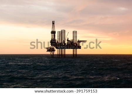 Silhouette of a drilling rig