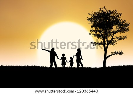 Silhouette of a family having holiday on sunset background