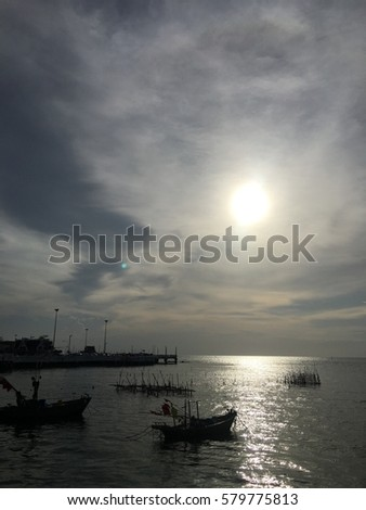 Silhouette of a fishing boat in the sea at Cape podium in Chonburi, Thailand.