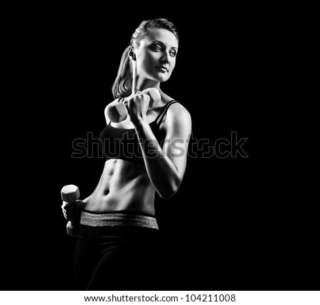 Silhouette of a fitness young woman on black background - stock photo