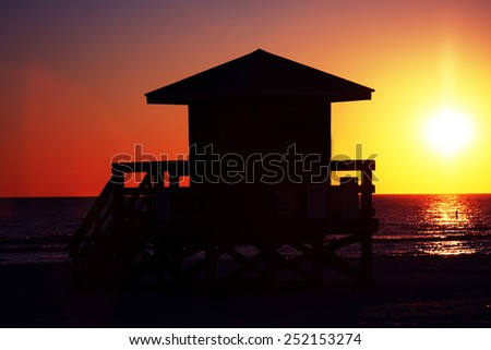 Silhouette of a Florida Lifeguard Station at Sunset. - stock photo