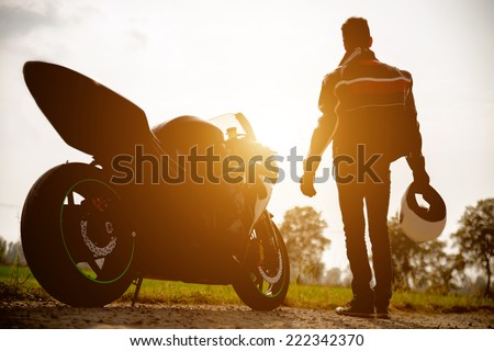 silhouette of a generic sport motorbike and biker. concept of people, transportation - stock photo