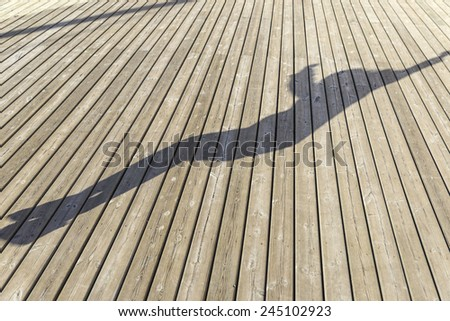 silhouette of a girl jumping on a old wooden floor