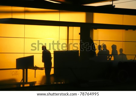 Silhouette of a guardians in a travel inspection point - stock photo