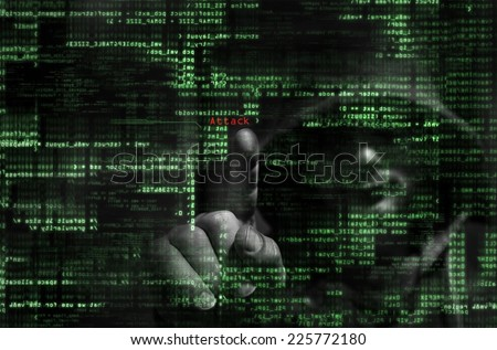 Silhouette of a hacker  on graphic user interface  - stock photo