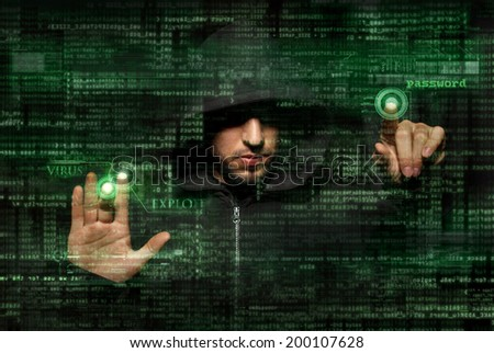 Silhouette of a hacker use  command of virus attack on graphic user interface - stock photo