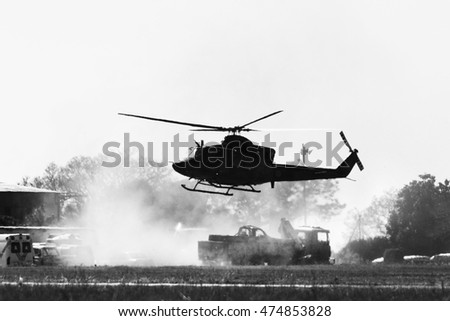 Silhouette of a Helicopter coming in to land