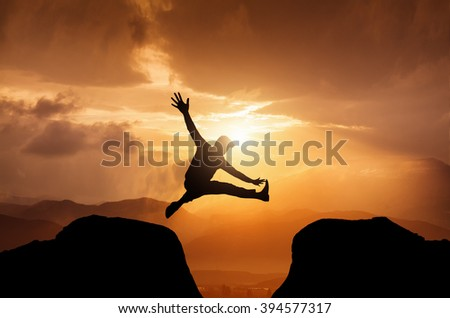 Silhouette of a jumping  man on summit
