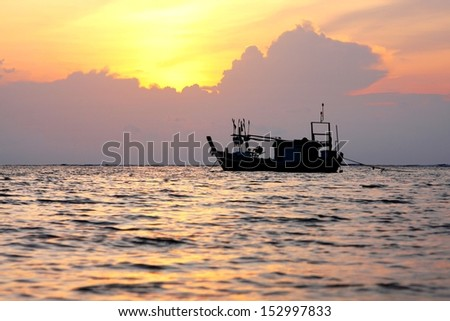 Silhouette of a local fishing boat in andaman sea at Phuket, Thailand with beautiful sky