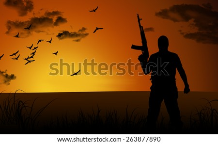 Silhouette of a lone soldier suicide at sunset - stock photo
