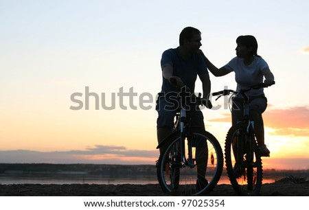 silhouette of a loving couple - stock photo