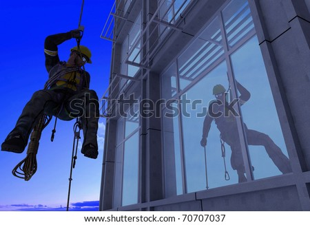 Silhouette of a man against a building. - stock photo