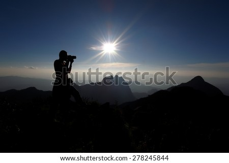 Silhouette Of A Man At The Top Of The Mountain