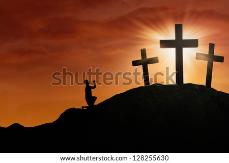 Silhouette of a man begging for God's mercy and love under Sunset background