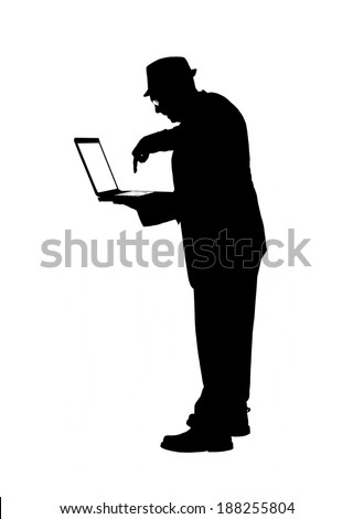 Silhouette of a man in a suit and hat and using a laptop computer isolated on white. - stock photo