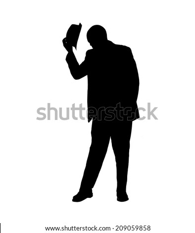 Silhouette of a man in a suit tipping his hat and bowing his head in a gesture of respect isolated on white. - stock photo