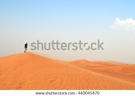 silhouette of a man in the rays of the setting sun in the desert in the United Arab Emirates