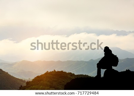Silhouette of a man on the mountain at sunset