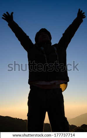 Silhouette of a man on the sunrise background.