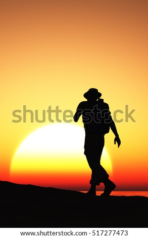 Silhouette of a man on the Sunset.,3d render