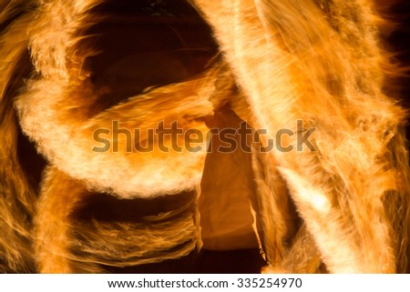 silhouette of a man on yellow firestorm  - stock photo
